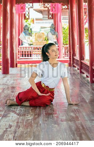 Beautiful young girl Thai Dancing art pantomime performances action of Thailand khon is the main dramatic art form of Thailand Wat Phra Khao temple in ayutthaya province