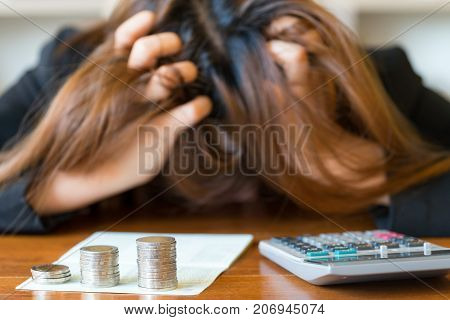 Stressed businesswoman running out of money - stock and market down