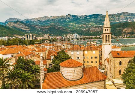 Landscape of Old town Budva: Ancient walls and red tiled roof. Montenegro, Europe. Budva - one of the best preserved medieval cities in the Mediterranean and most popular resorts of Adriatic Riviera.