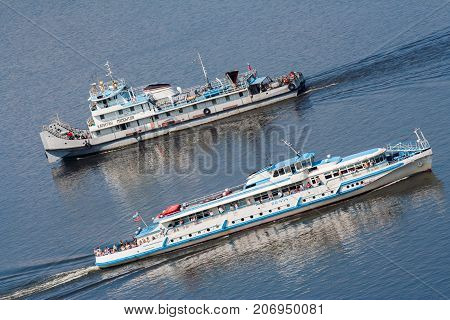Russia, Nizhny Novgorod - Summer 2007: Two steamships swim along the river