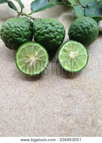 Kaffir Lime or Bergamot on plywood background