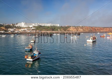 Fishing boats and ships on an overnight stay at the port. Sagres Portugal