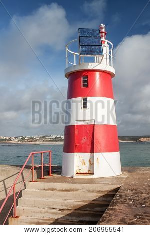 Breakwater with a lighthouse to guide. Sagres Algarve