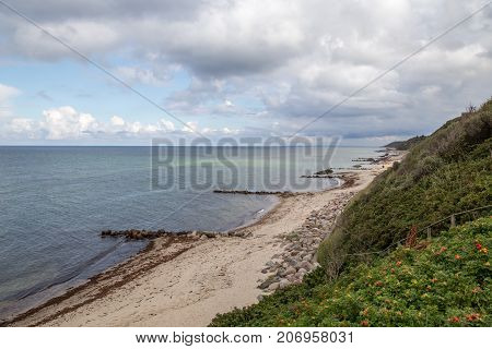 Tisvilde, Denmark - September 16, 2017: View of the coastline with breakwaters
