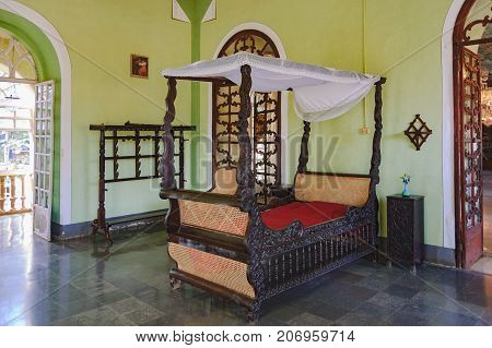 Goa, India - November 16, 2012: Menezes Braganza Pereira House - colonial Villa-Museum of Portuguese era with decoration of 16-18 century. Old bed of the mistress of the house interior of bedroom