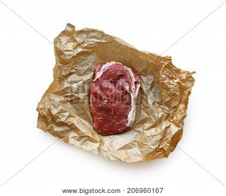 Raw beef steak in craft paper isolated on white background, top view. Cooking ingredients, butcher's and grocery concept