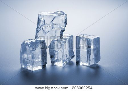 group of melted ice cubes on gray background