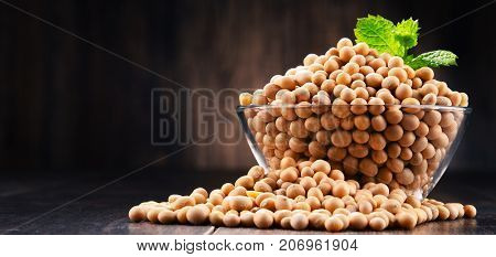 Composition With Bowl Of Soya Beans On Wooden Table