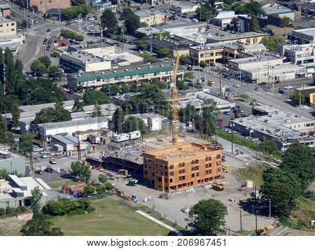 SEATTLE-- JUNE 25: Aerial view of downtown Seattle building under construction and surrounding area on June 25 2016 in Seattle WA.