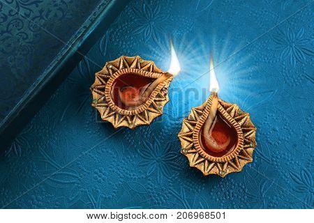 Beautiful Golden Diwali Diya Lamp Lights on Blue Background