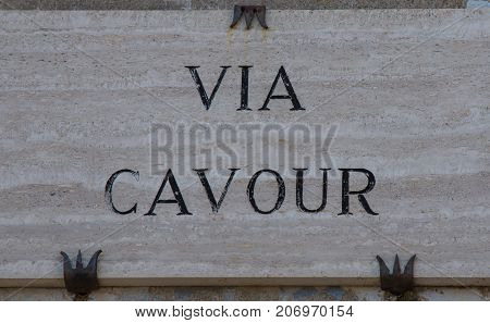Marble slab engraved with via Cavour in Italy