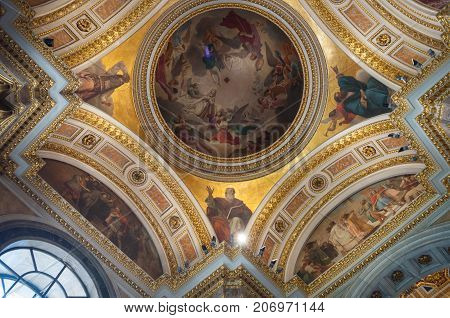 ST PETERSBURG RUSSIA - AUGUST 15 2017. Icons and dome ornated with Bible scenes in the interior of the St Isaac Cathedral in St Petersburg Russia