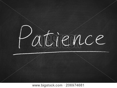 patience concept word on a blackboard background