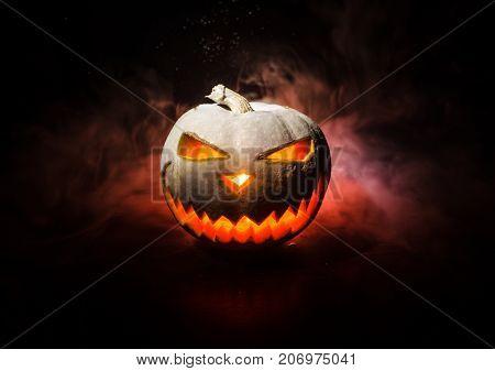 Halloween - Old Jack-o-lantern On Black Background. Closeup Of Scary Halloween Pumpkins
