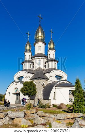facade of a modern church in the village of Buki Ukraine. October 11 2014