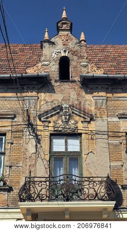 old beautiful building bas-reliefs in need of restoration