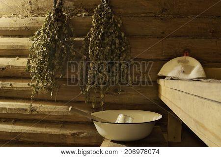 Ritual accessories and traditional interior of Russian sauna - banya