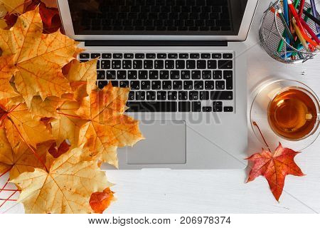 Girly Office Desktop With Blank White Laptop Screen, Flowers, Coffee, Smartphone And Various Office