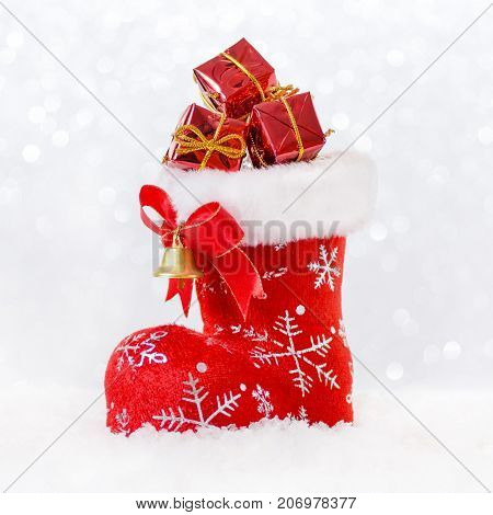 red santa's stocking with gifts in snow, christmas card, square