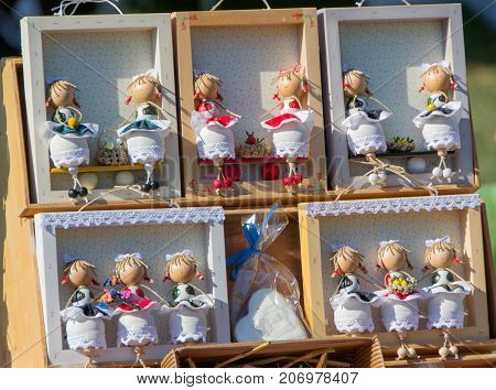 Hand-made wooden dolls on the street sale of souvenirs