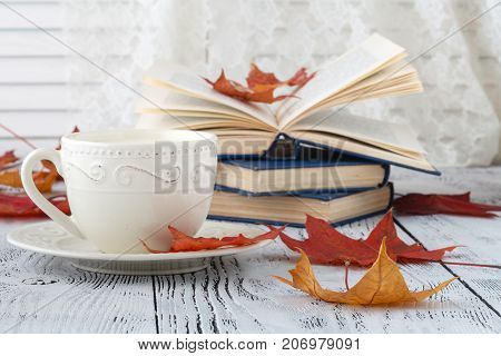 Autumn Leaves And Black Coffee Composition. Coffee Cup At Weathered Rustic Wood Background. Fall Hot