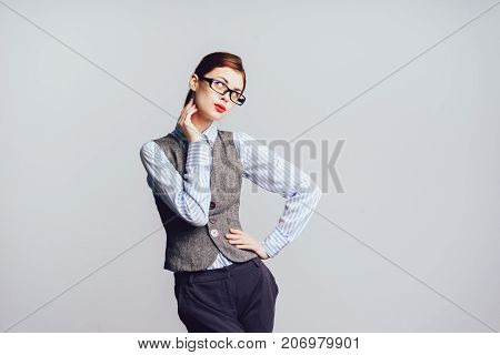 flirtatious girl in a tight suit and wearing glasses on a white background