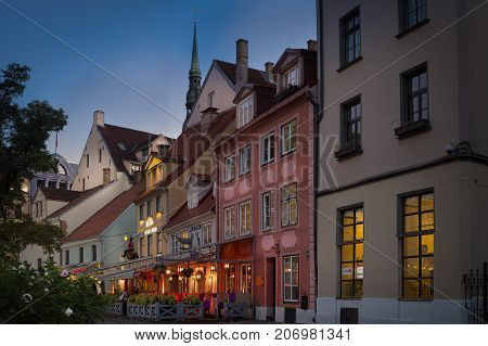 RIGA, LATVIA, AUGUST 15, 2016: Night view of a restaurant in the old town of Riga, Latvia.