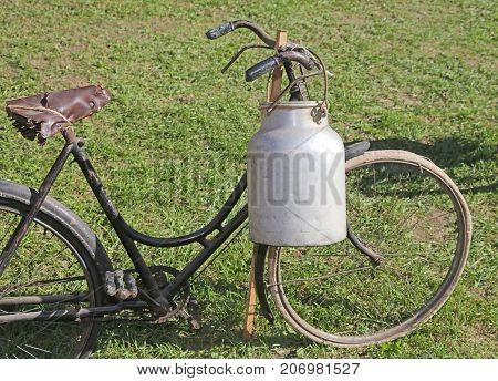 Old Bicycle With Aluminum Milk Canister