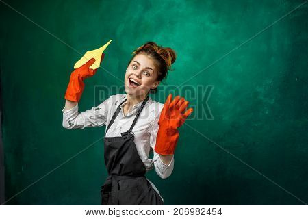 funny girl in gloves is going to do cleaning