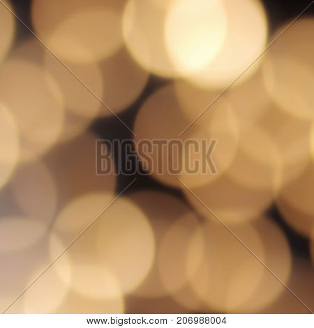 Golden Bokeh On A Black Background, Abstract Dark Backdrop With Defocused Warm Lights And Blue Highl