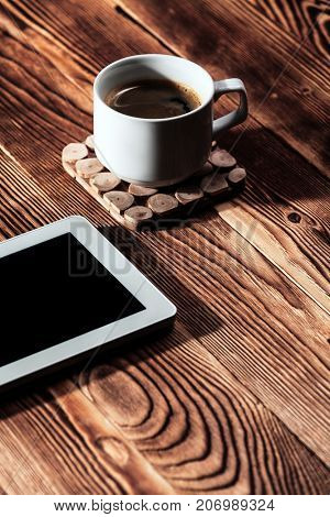 white tablet pc isolated on a wooden background
