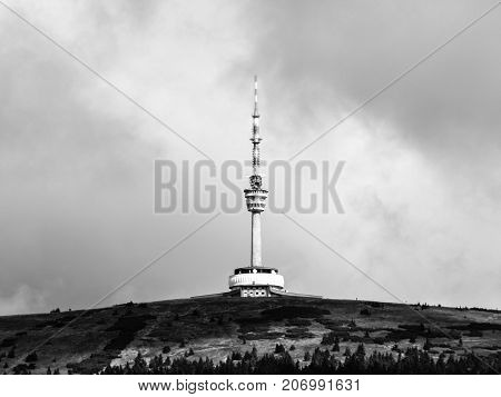 TV transmitter and lookout tower on the summit of Praded Mountain, Hruby Jesenik, Czech Republic. Black and white image.