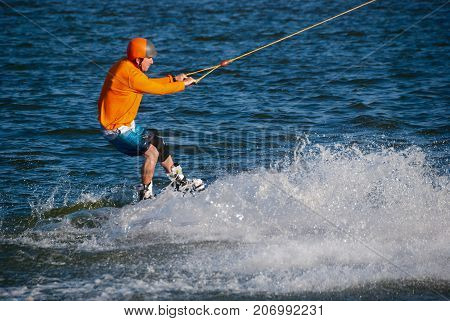 Concentrated Man Rides Fast During Training In Wakeboarding