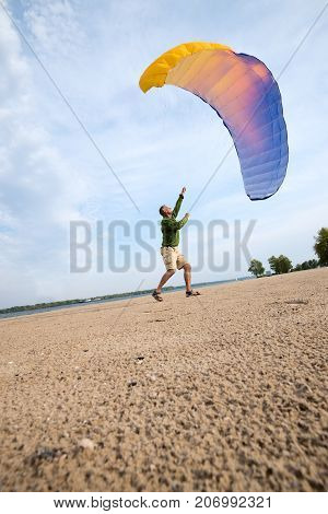 Enthusiastic Adventurer Is Training With A Kite, Paraglider