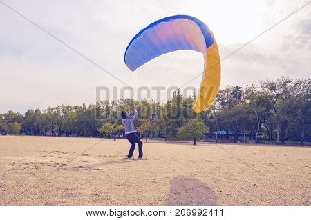 Man Is Practicing To Control A Paraglider