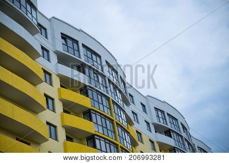 new building with apartments with blue sky on background