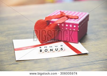 Yearly Bonus Concept / Card Bonus In Paper Envelope With Gift Box Surprise And Red Heart For Encoura