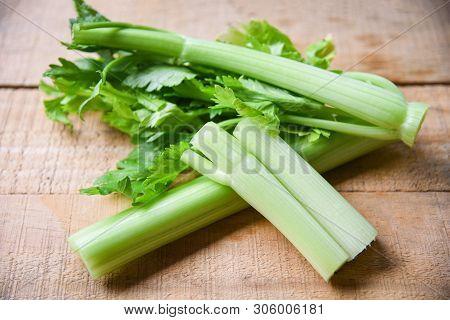 Celery Sticks And Leaf Fresh Vegetable / Bunch Of Celery Stalk On Wooden Background