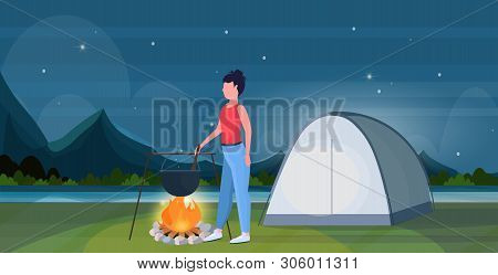 Woman Hiker Cooking Meals Girl Preparing Food In Bowler Boiling Pot At Campfire Hiking Concept Trave