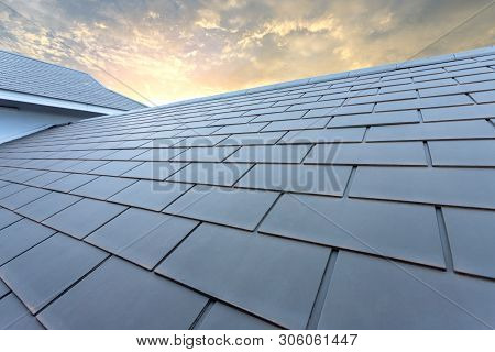 Slate Roof Against Blue Sky, Gray Tile Roof Of Construction House With Blue Sky And Cloud Of The Sun