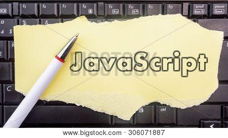 Javascript Programming Language. Paper Width Word Javascript And Pencil On Laptop Keyboard