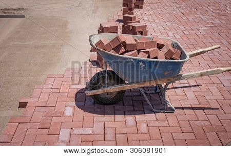 Stone Pavers bricks being layed  on ground for landscaping project.