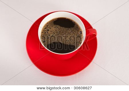 Red Cup And Saucer With Black Coffee