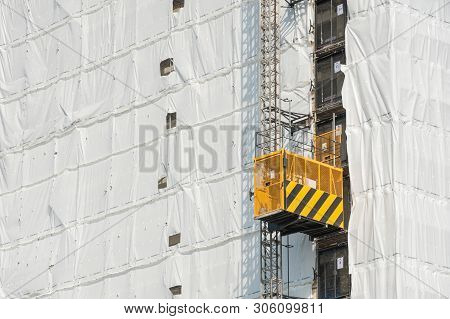 Small Elevator On The Exterior Of A Tower Block Building Construction