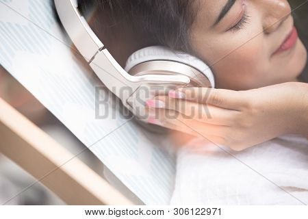 Beautiful Girl Relaxing Pool Side Beauty Concept.happy Girl Smile Anf Listen To Music With Headphone