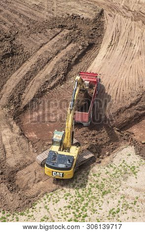 Toronto, Canada - April 25, 2019: A Caterpillar Is Digging In A Construction Site