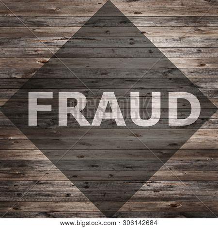 Fraud text on seasoned wood background.