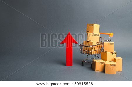 Shopping Cart With Cardboard Boxes And Red Up Arrow. Growth Wholesale And Retail. Improving Consumer