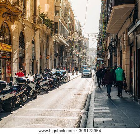 Barcelona, Spain - Nov 14, 2017: Typical Day Over Carrer Nou De La Rambla Street With Pedestrians To