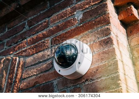 Barcelona, Spain - Nov 14, 2017: Axis 360 Degrees Surveillance Camera On Brick Wall. Axis Communicat